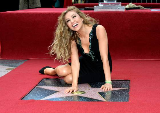 Mexican singer-songwriter Thalia poses on her star after it was unveiled on the Hollywood Walk of Fame
