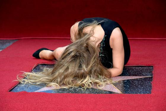 Mexican singer-songwriter Thalia rests on her star after it was unveiled on the Hollywood Walk of Fame