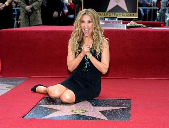 Performer Thalia poses on her star after it was unveiled on the Hollywood Walk of Fame in Hollywood